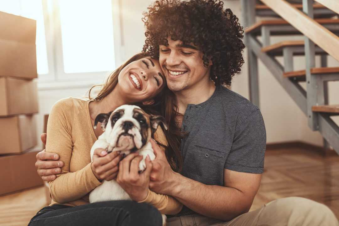 young couple with new puppy for valentines day